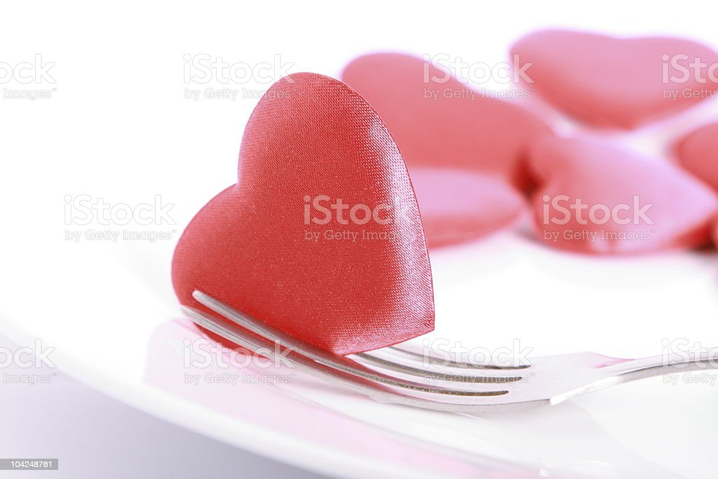 Heart pierced by fork royalty-free stock photo