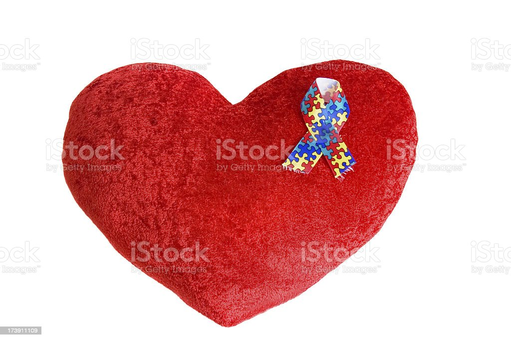 Heart pillow with Autism ribbon on it royalty-free stock photo