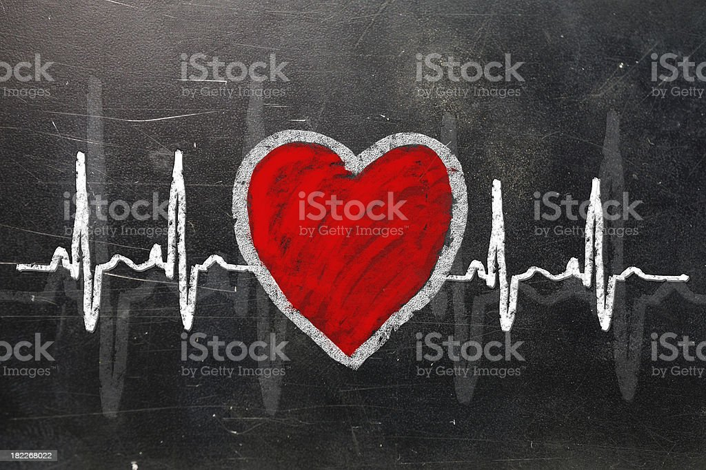 Heart rate monitor line with heart on chalkboard royalty-free stock photo