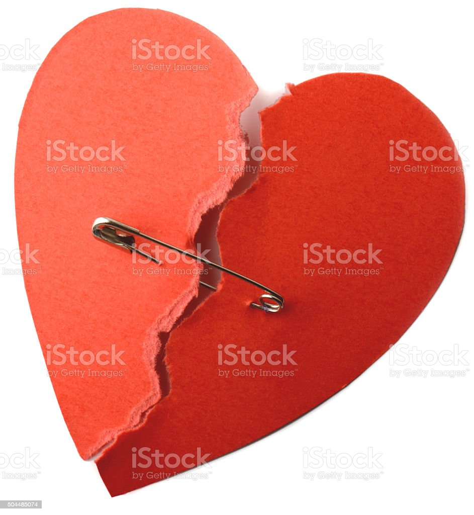 Heart safety pin stock photo