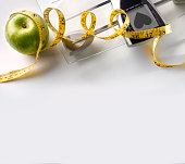 Heart scale with apple and tape measure square composition top