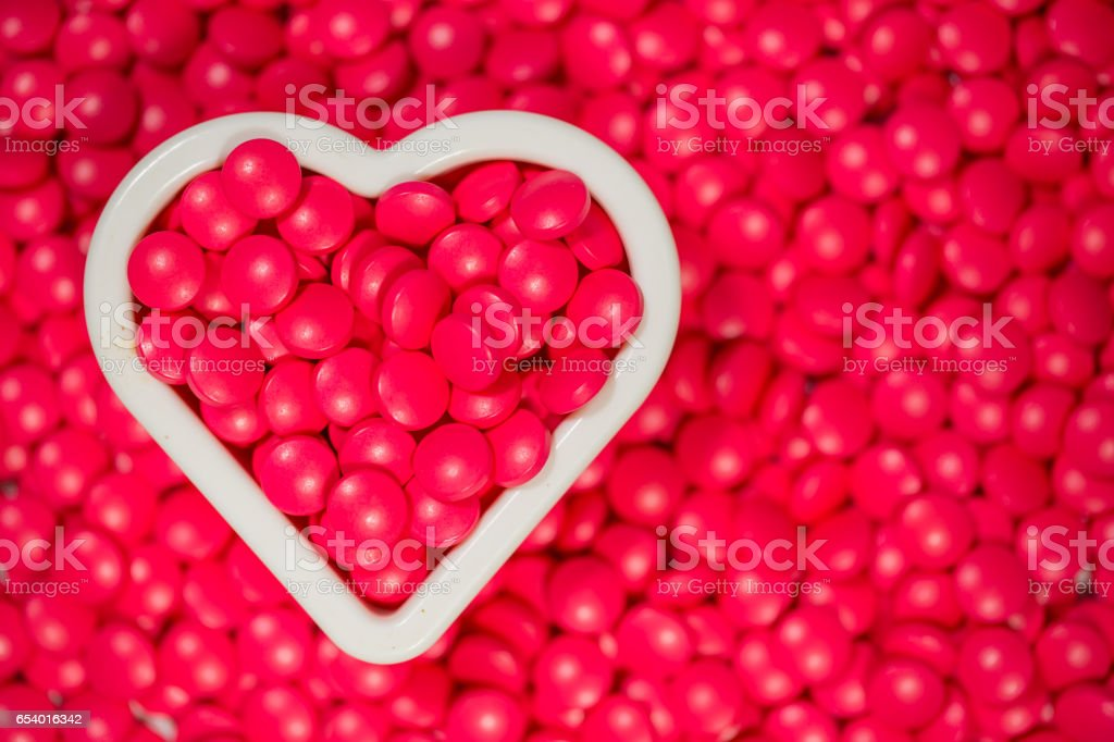 heart shape and red pill background, top view stock photo