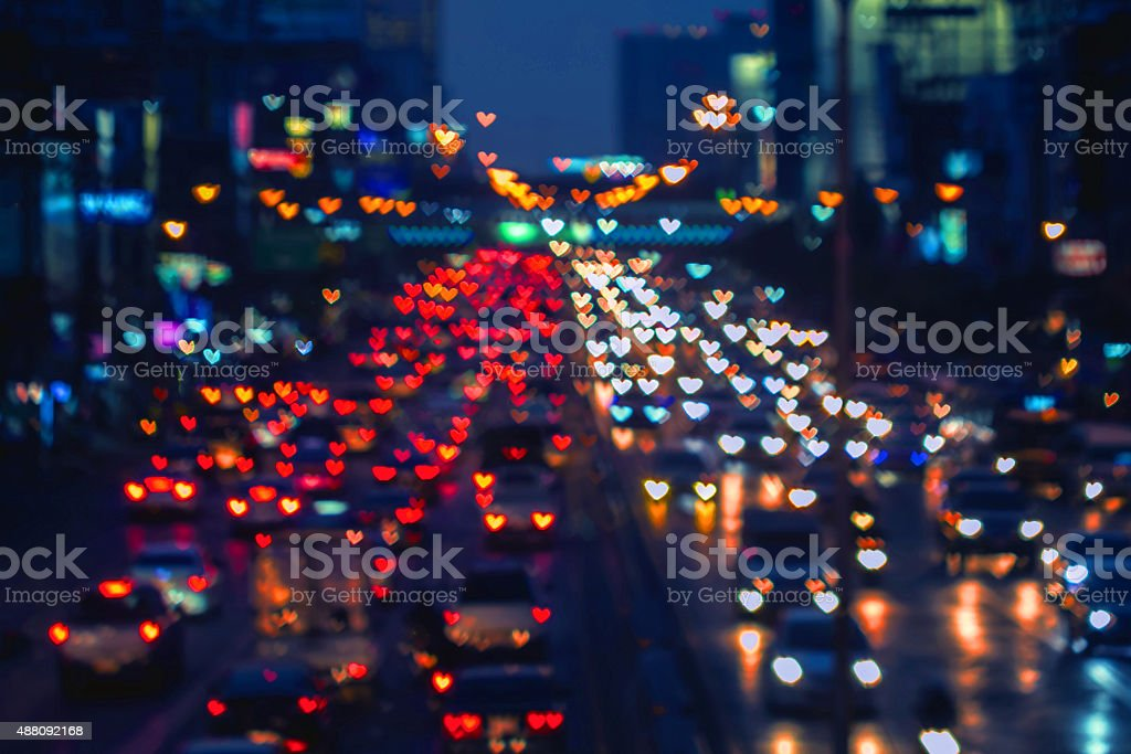 Heart shape bokeh from car light on the traffic road stock photo