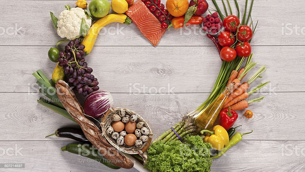 Heart shape by various vegetables and fruits stock photo