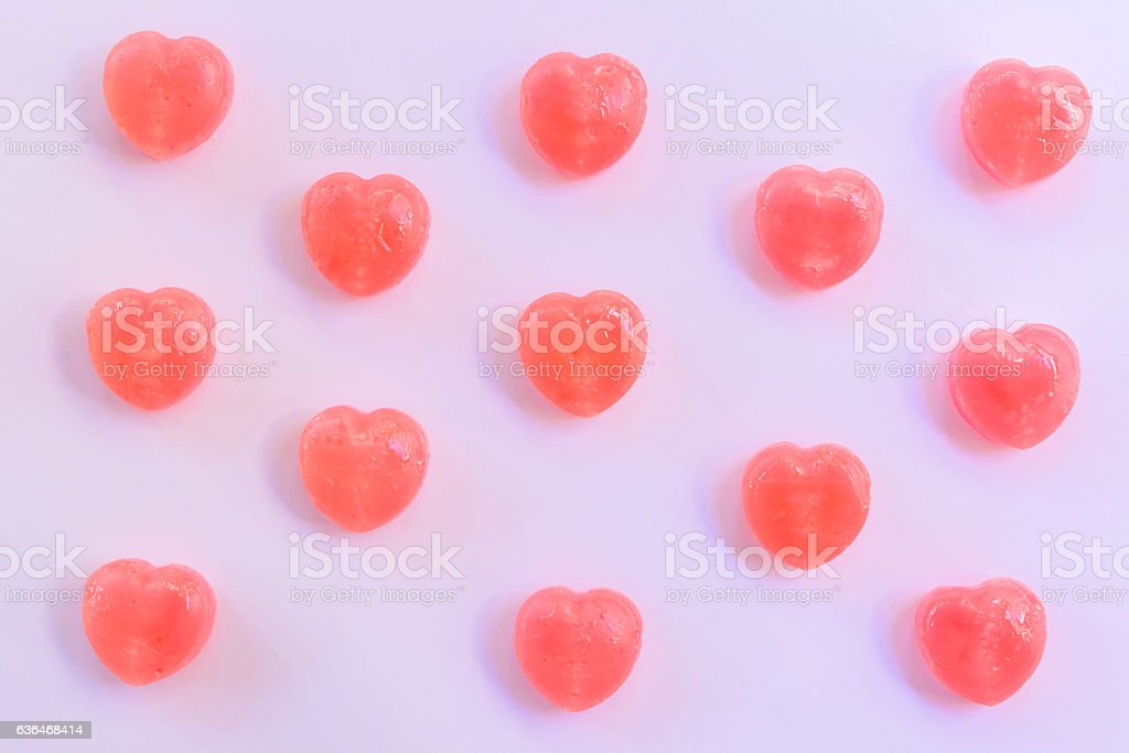 heart shape candy on paper background stock photo