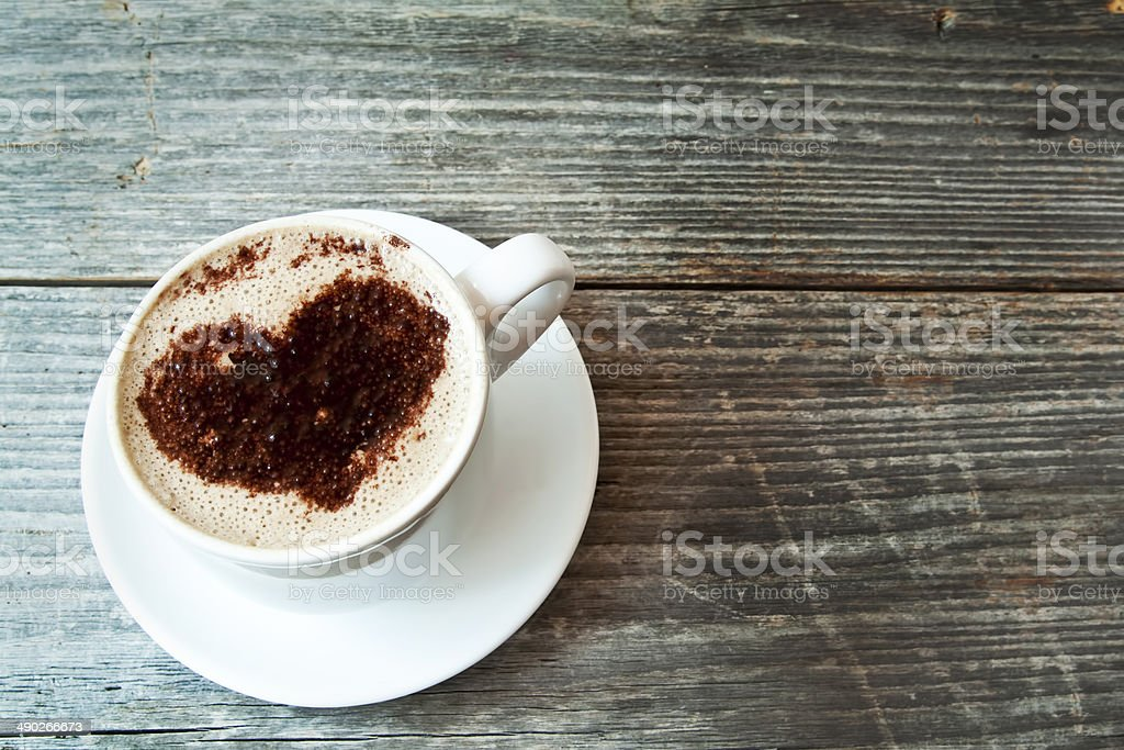 Heart Shape Cappuccino Cup on Wooden Background stock photo