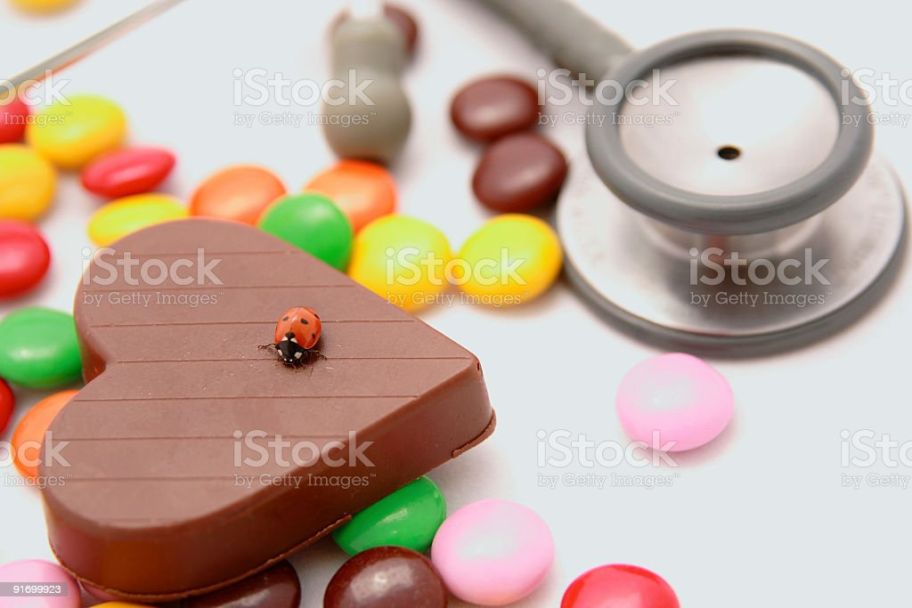 Heart shape chocolate's ladybug royalty-free stock photo