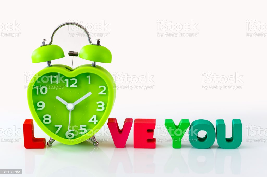 Heart Shape Clock with Wooden Alphabets for Valentine's Concept stock photo
