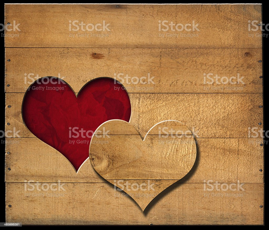 Heart Shape cut on Old Wooden Boards stock photo