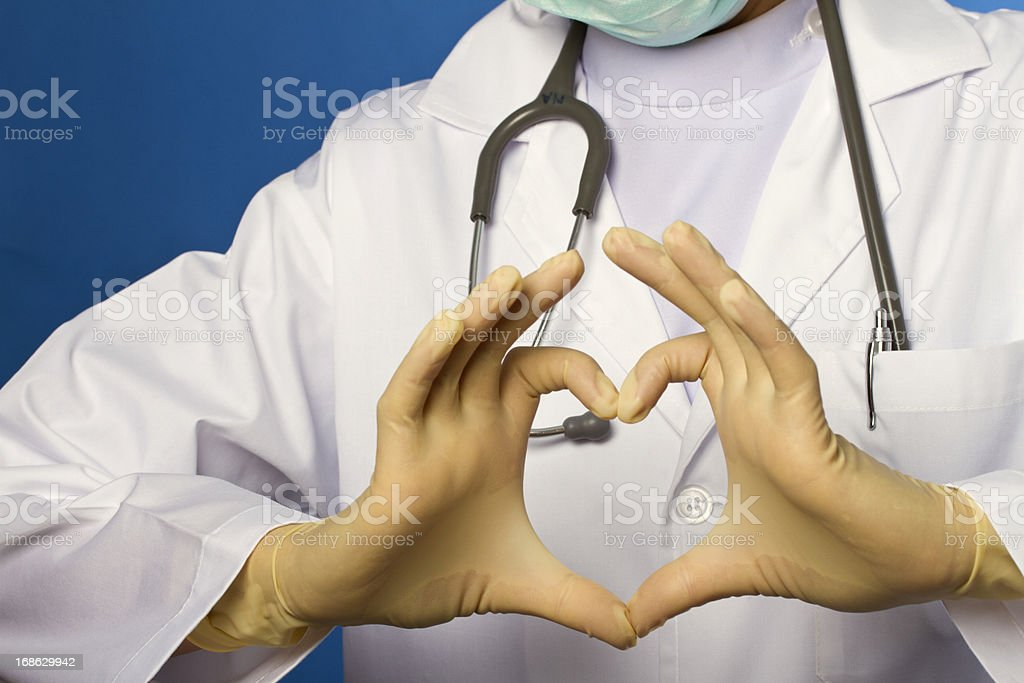 Heart shape from a nurse in uniform royalty-free stock photo