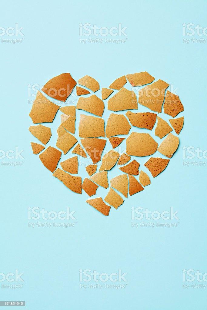 heart shape from broken eggshells stock photo