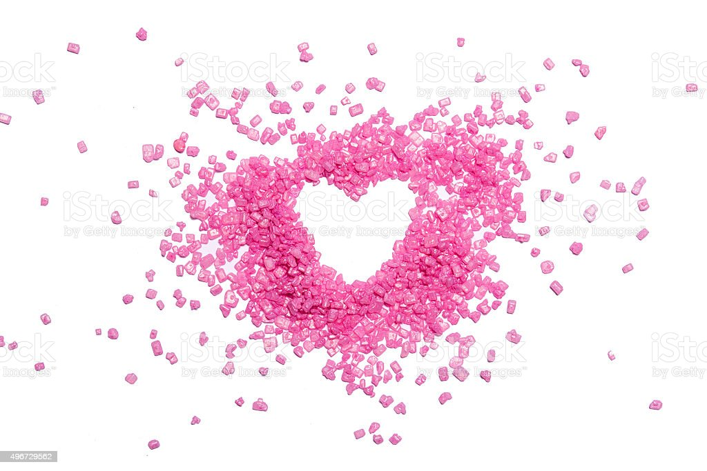 Heart shape from pink candies on white background stock photo