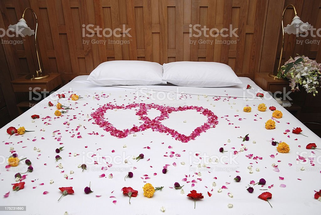 Heart shape from rose and flower on wedding bed royalty-free stock photo