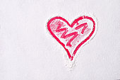 Heart shape in a flour on red board. Love sign