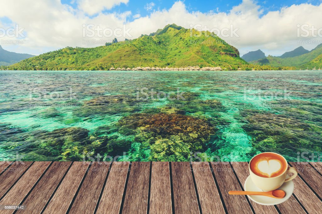 Heart shape in hot cappuccino coffee cup on Moorae Island at Tahiti blackground stock photo