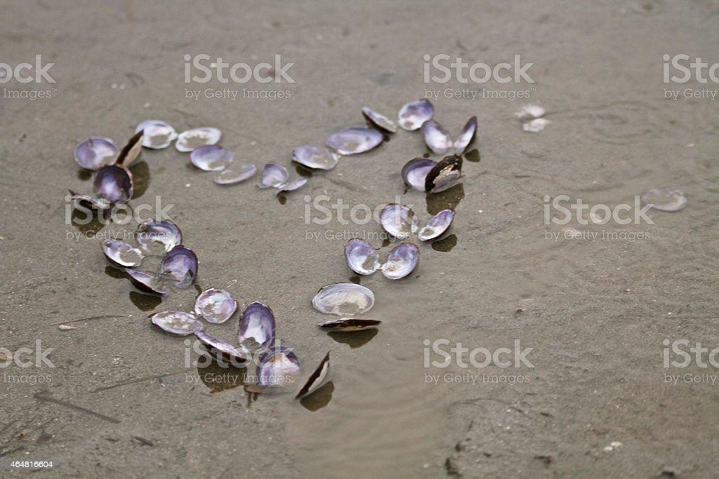 Heart shape in sand stock photo