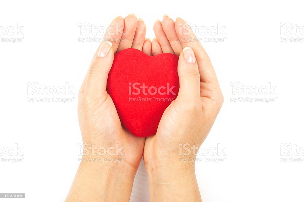 Heart shape in the palm of hand royalty-free stock photo