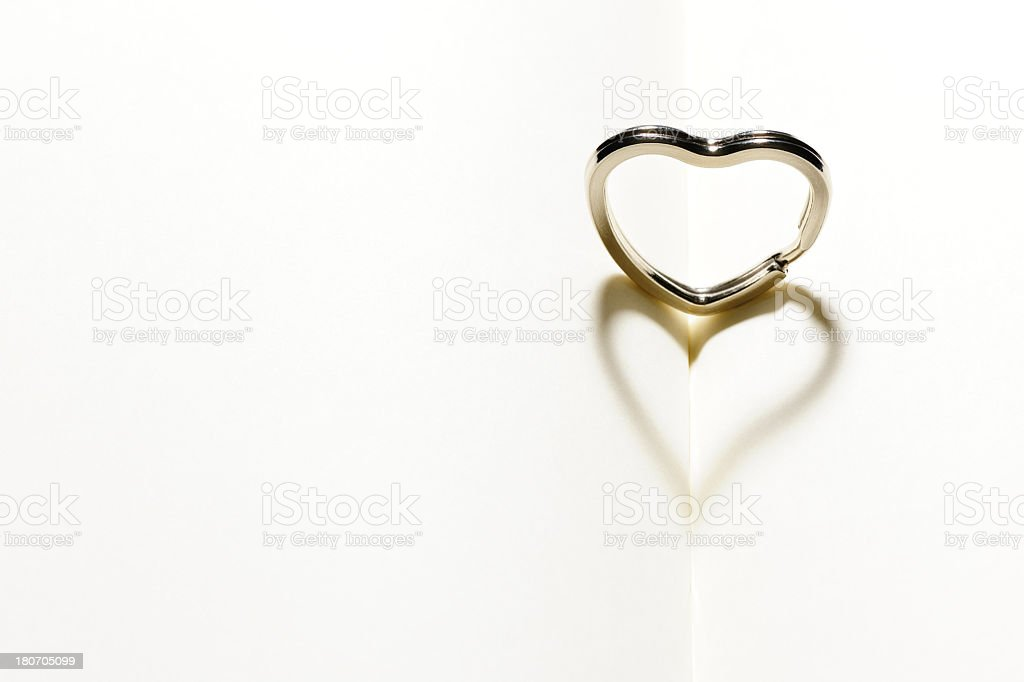 Heart shape key ring on blank book with shadow royalty-free stock photo