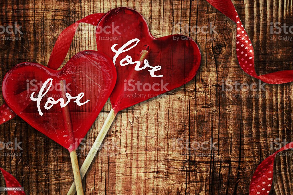 Heart shape lollipops on wooden background. stock photo