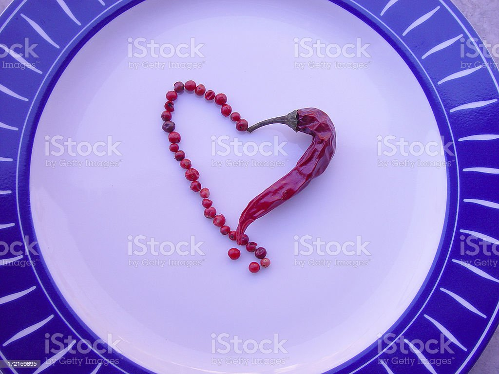 Heart Shape made by Chily Pepper and  Grains stock photo