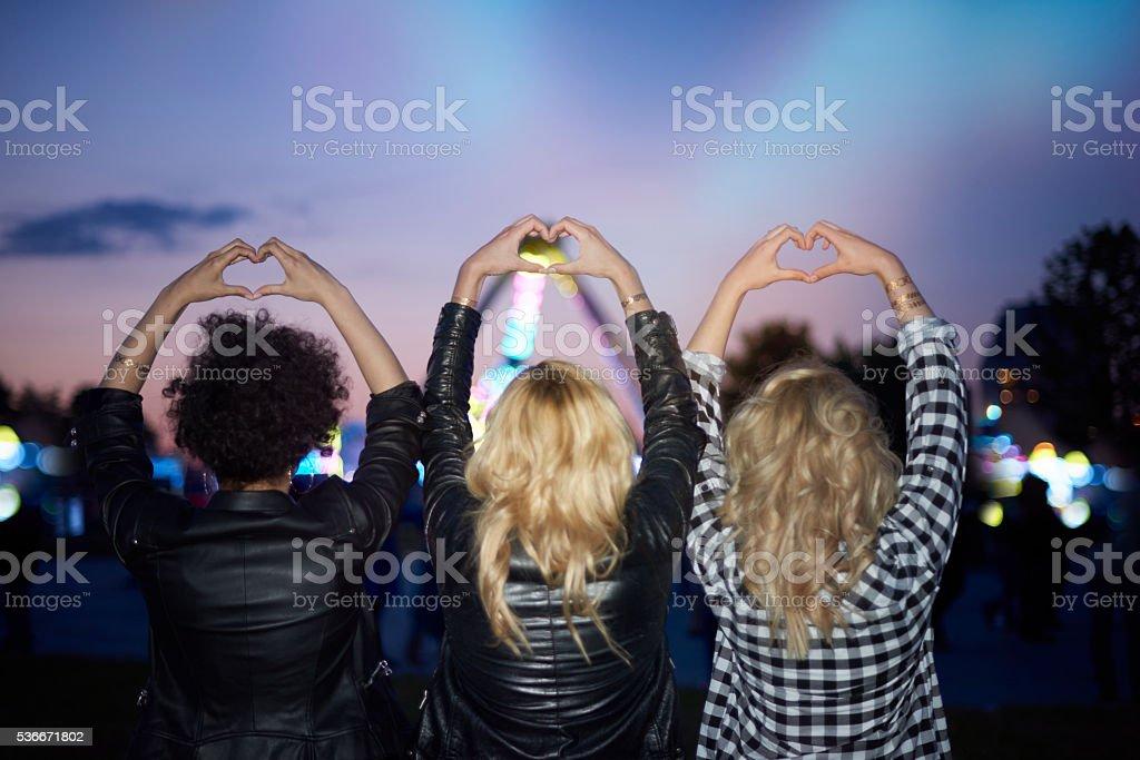 Heart shape made of human hands stock photo