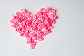 Heart shape made of pink ribbons