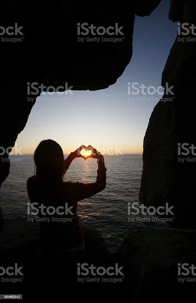 heart shape made with a girl hands stock photo