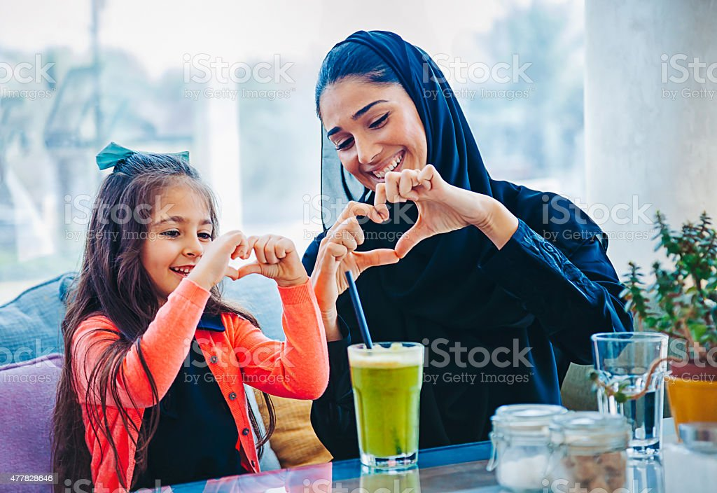 Heart shape made with hands stock photo