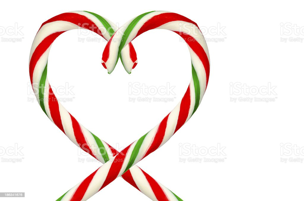Heart shape of sugar sticks isolated on a white background royalty-free stock photo