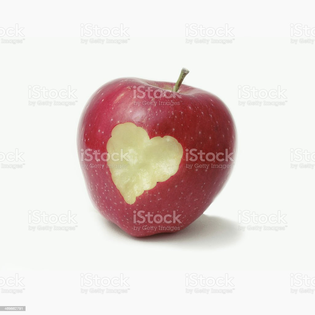 Heart shape on a delicious red apple stock photo