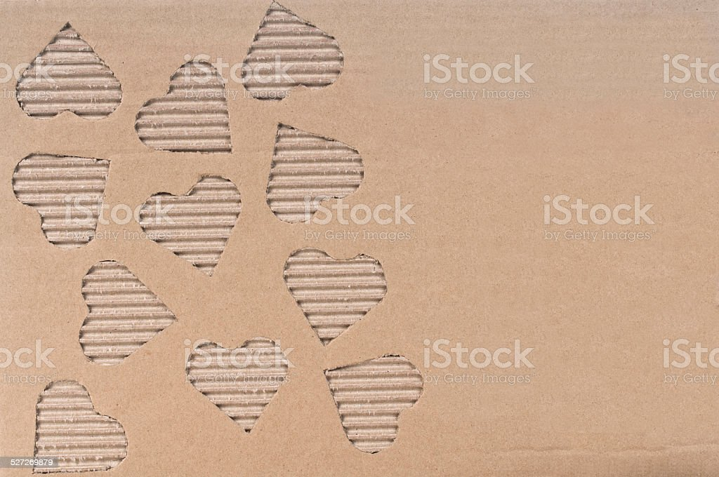Heart shape on cardboard stock photo