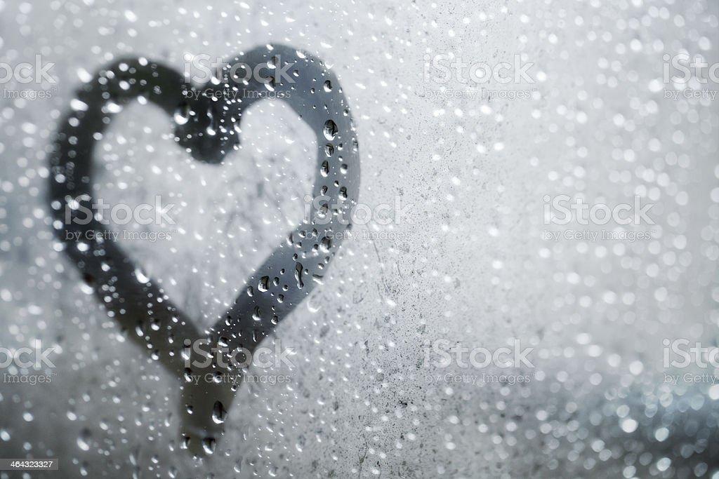 Heart shape on glass from finger stock photo