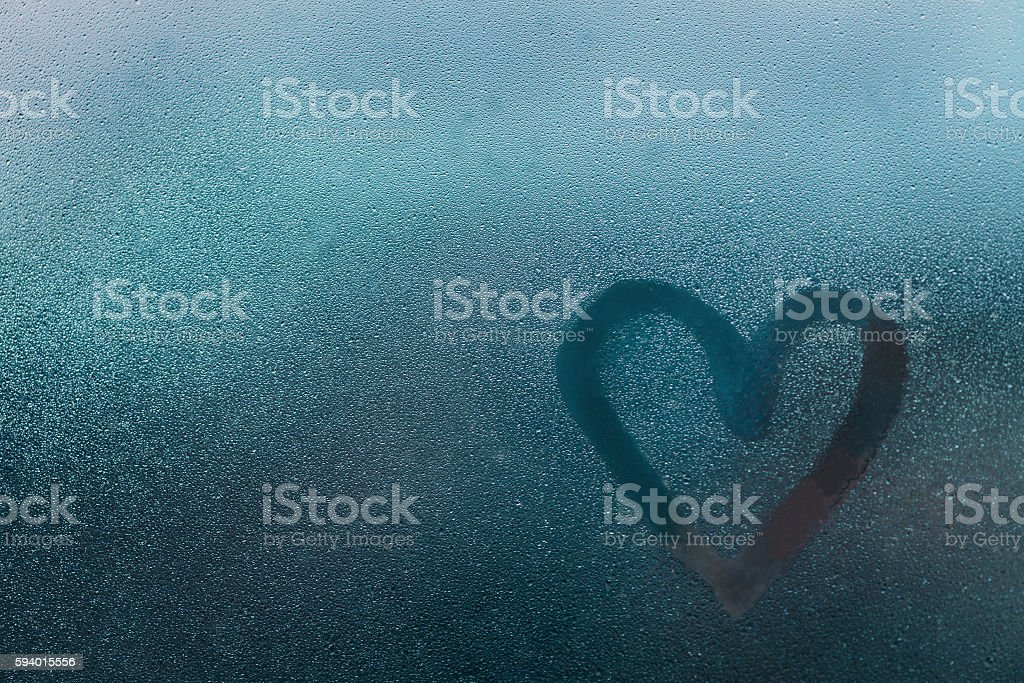 Heart shape on glass with water drops stock photo