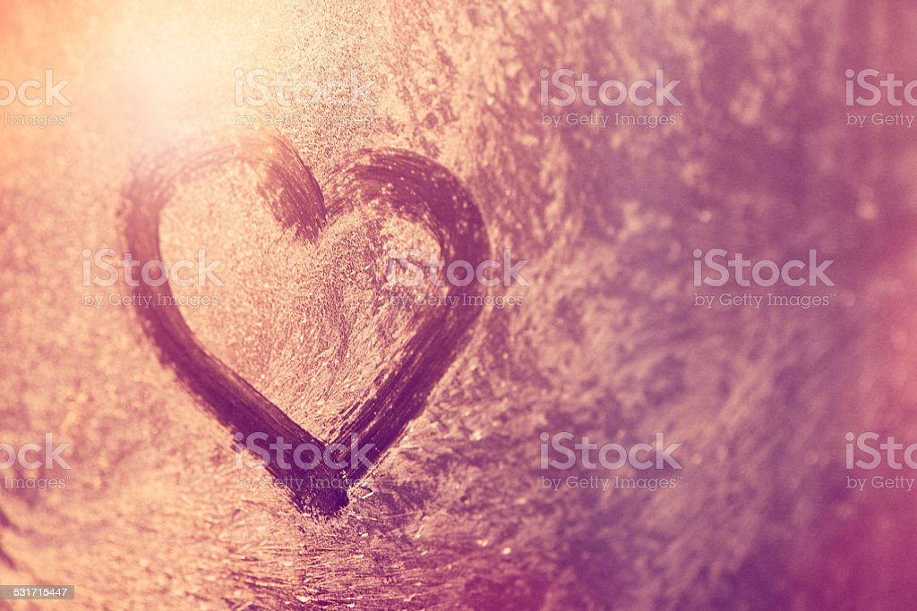 Heart shape on grass stock photo