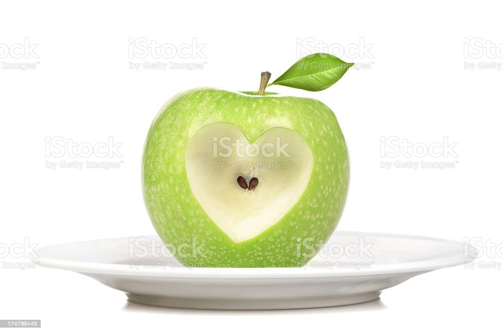 Heart shape on green apple royalty-free stock photo