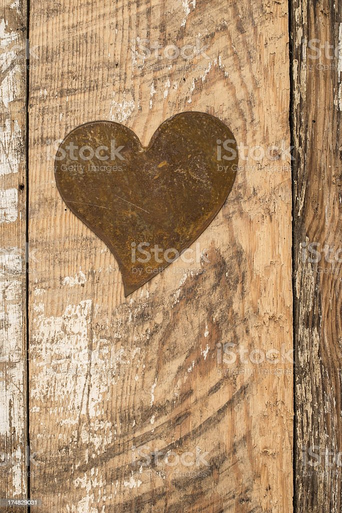 Heart shape on rustic wooden background royalty-free stock photo