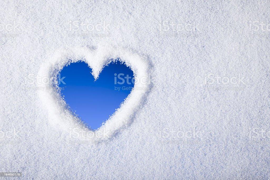 Heart shape painted on frozen window stock photo