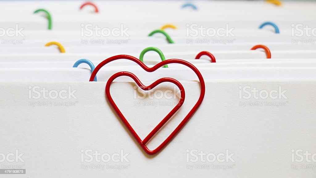 Heart shape paper clip stock photo
