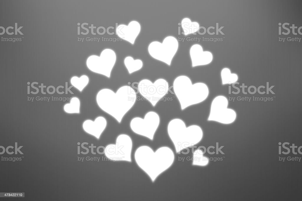Heart shape pattern against brushed metal background stock photo