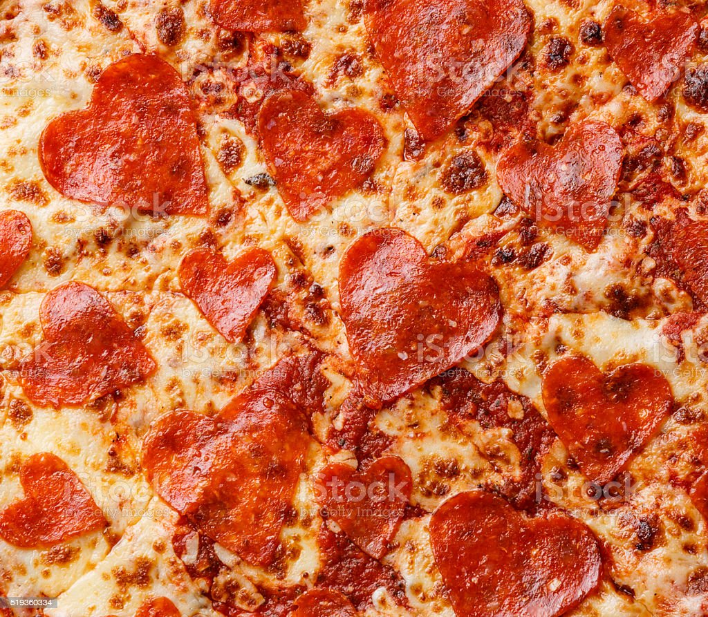 Heart shape Pepperoni Pizza background stock photo