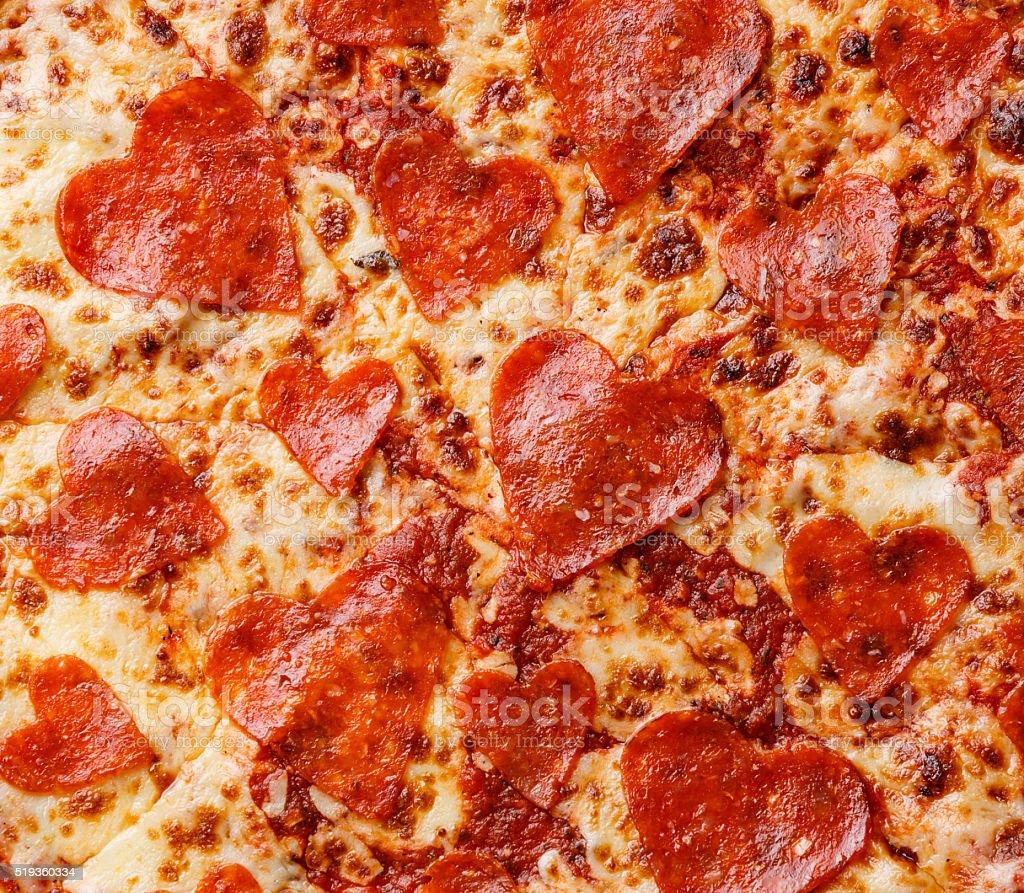 Heart shape Pepperoni Pizza background stock photo