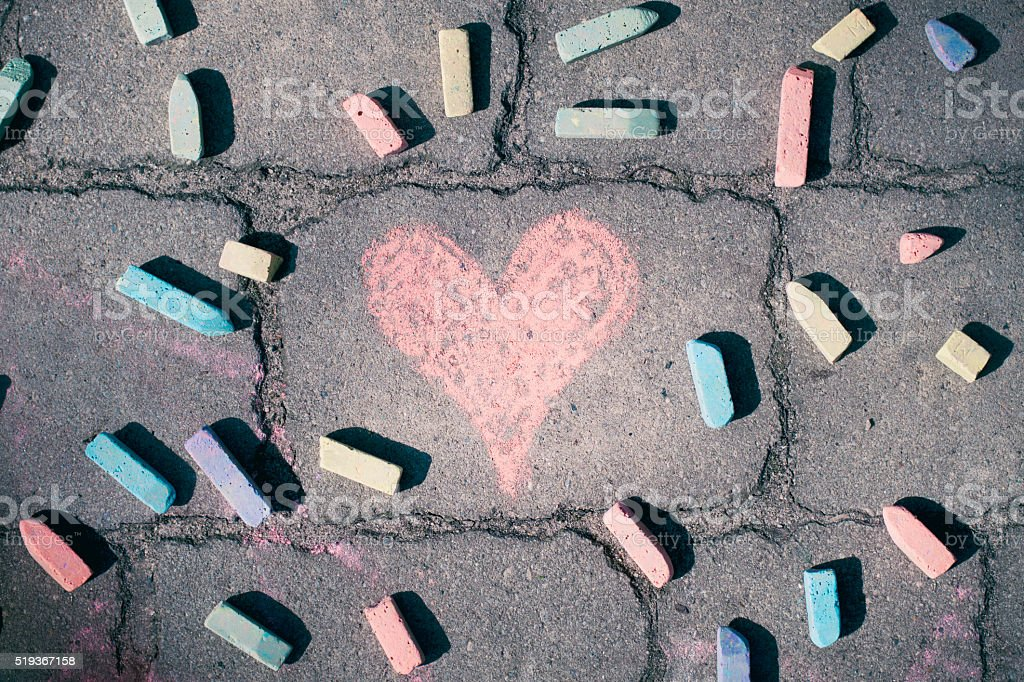 Heart shape, pieces of chalk on the sidewalk stock photo