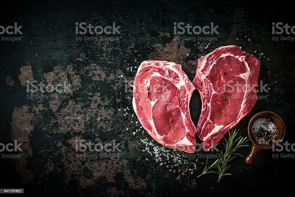 Heart shape raw fresh veal meat steaks stock photo