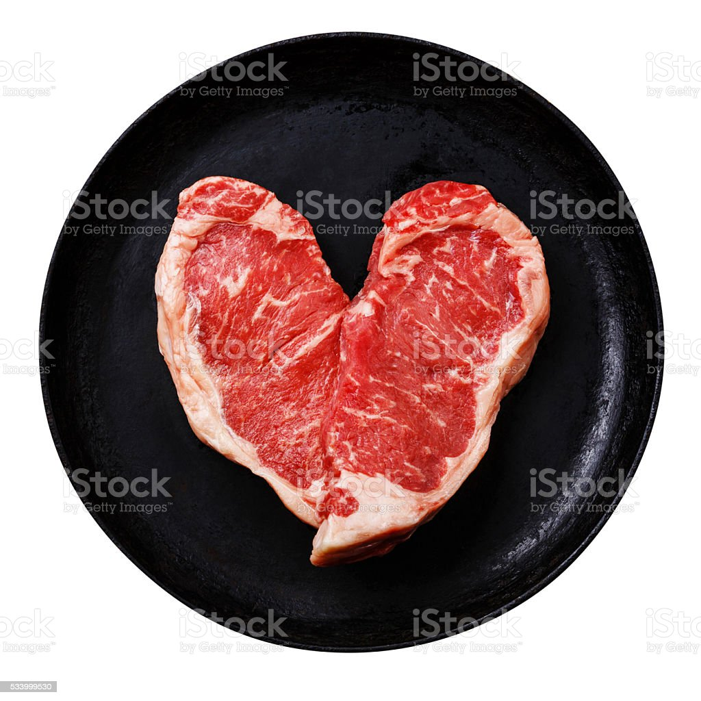 Heart shape Raw meat Steak isolated stock photo