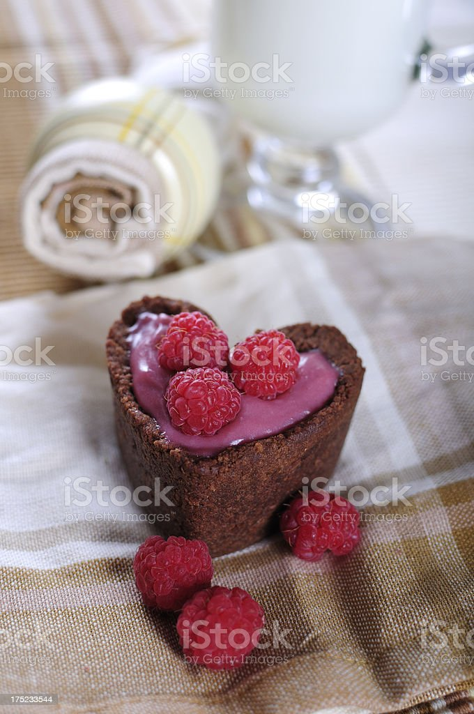 Heart shape tarts with cocoa and raspberry royalty-free stock photo
