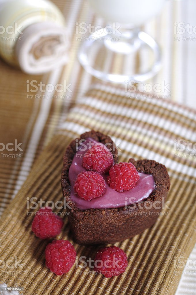 Heart shape tarts with cocoa and raspberry stock photo