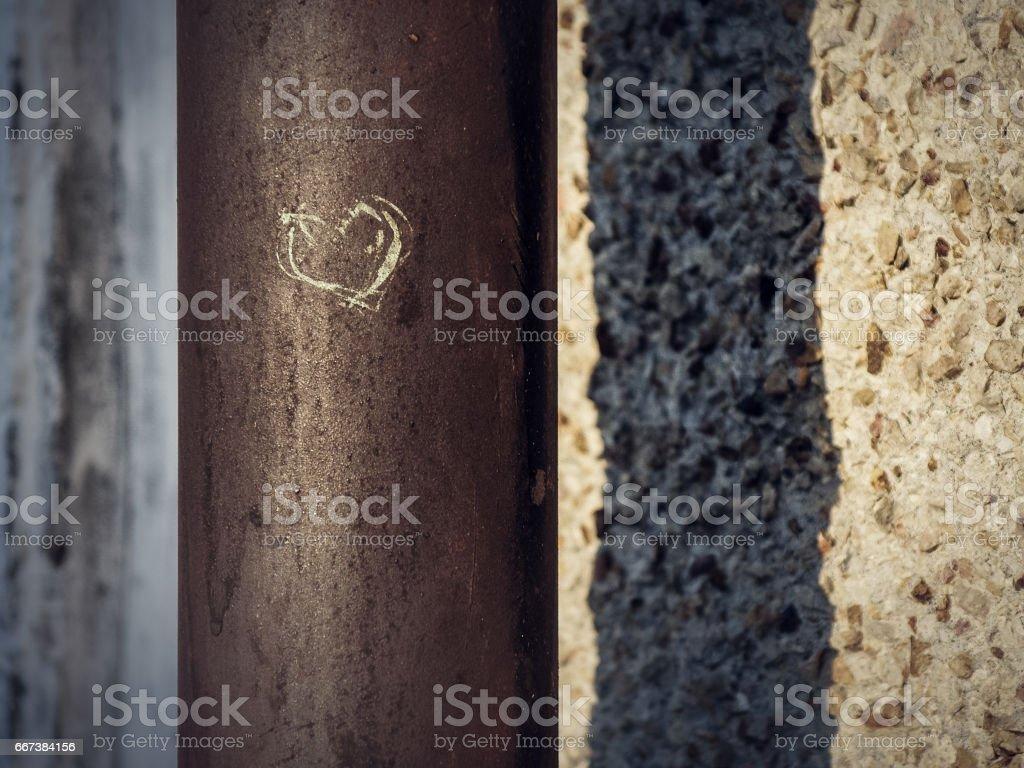 Heart shape urban grafity on a steel pipe stock photo