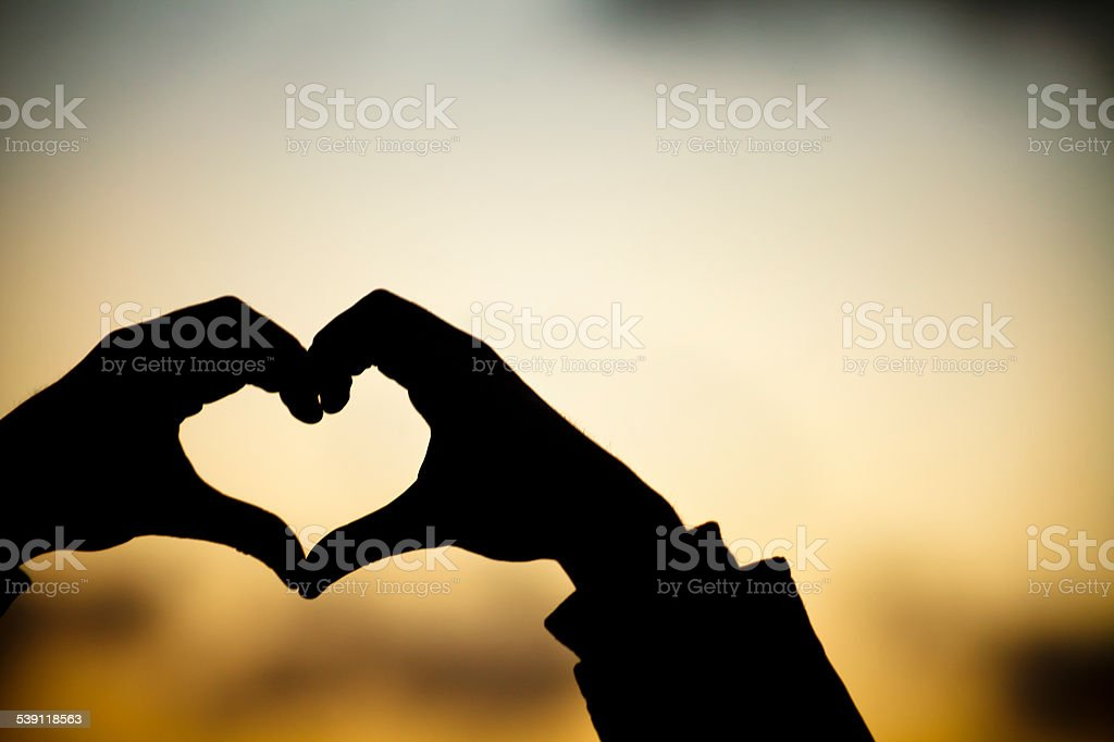 Heart shape with sunset background. stock photo