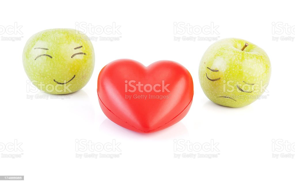 Heart shaped and green apples. royalty-free stock photo