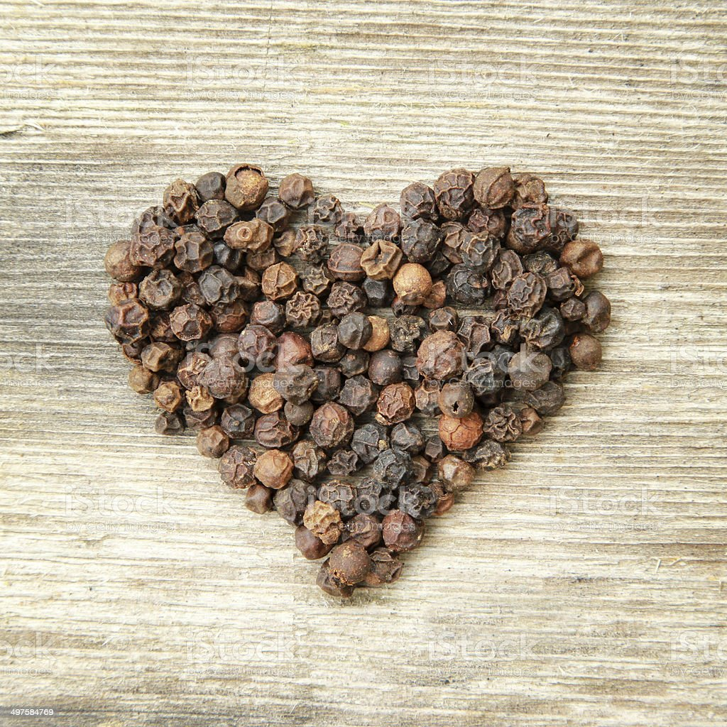 Heart shaped black pepper stock photo